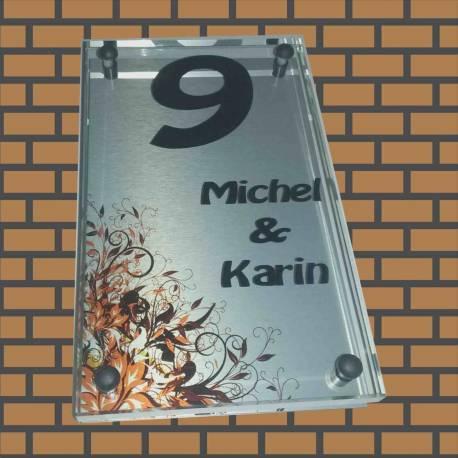 Glazen naambord met bloemen print op rvs look achterplaat